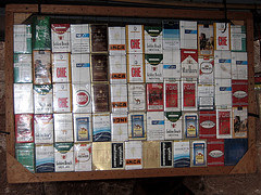 wall of different cigarette brand boxes