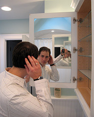 image of man seeing reflection in mirror of himself seeing his reflection in a mirror