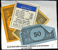 images of monopoly game money and property deeds